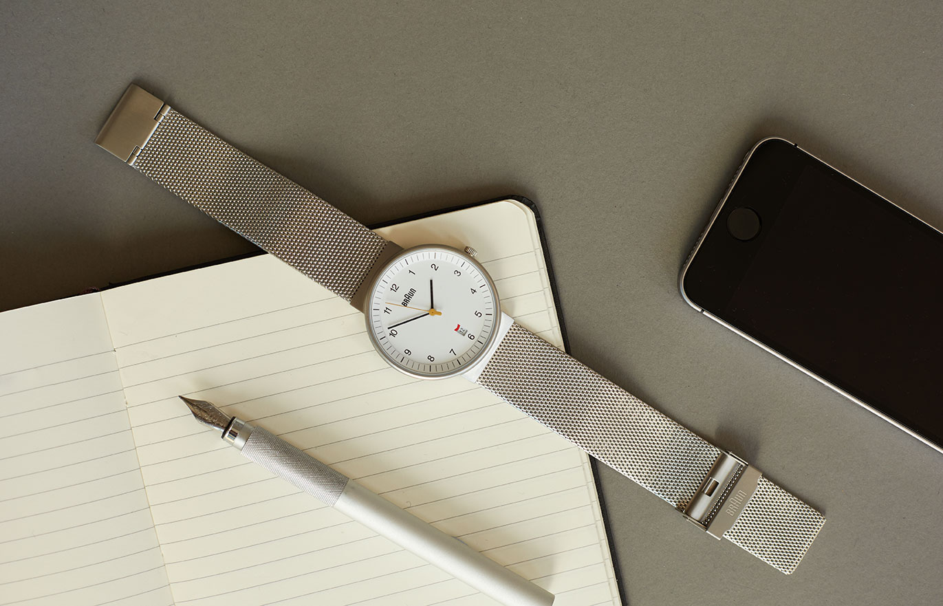 Watch with phone and notepad
