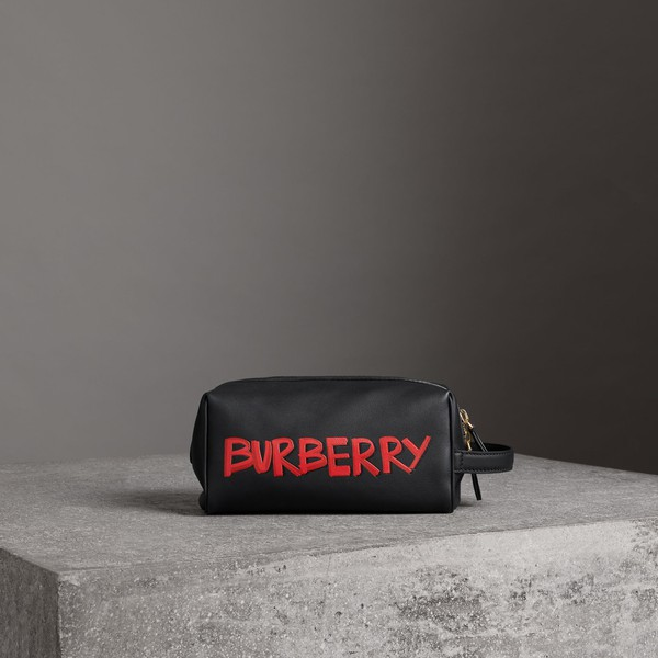 ef07afec1849 Graffiti Print Leather Pouch by Burberry — Thread
