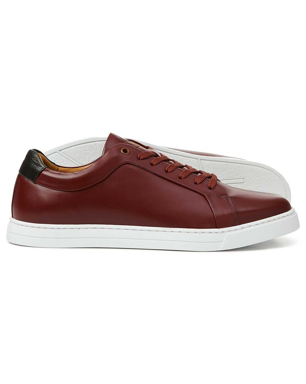 Burgundy leather trainers by Charles