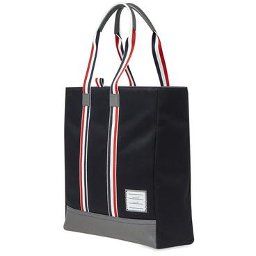 Burberry. EKD London Check and Leather Backpack. £860. Thom Browne.  Unstructured Tote 81402caa84418