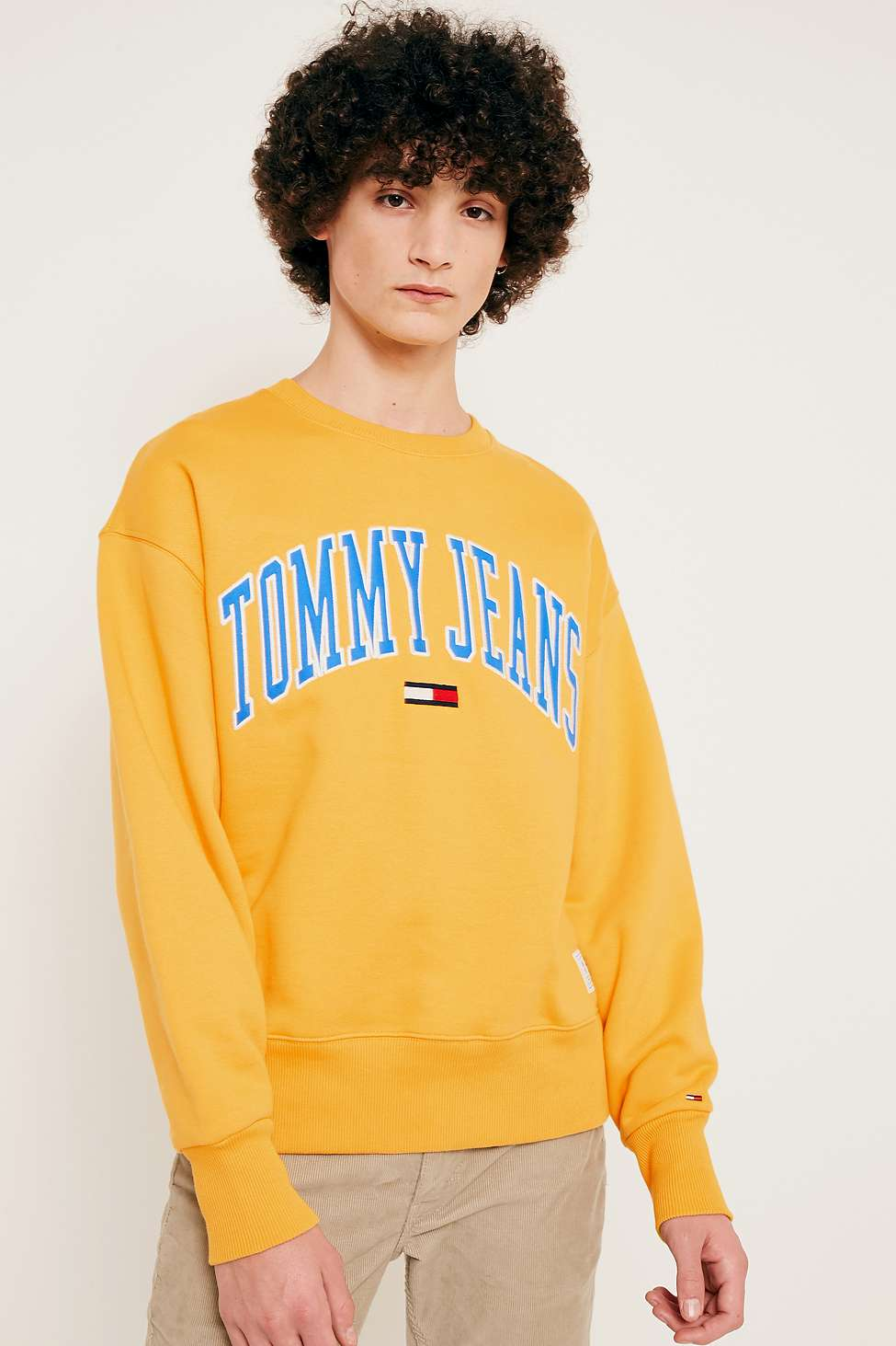 282db5c7 Collegiate Gold Sweatshirt by Tommy Jeans — Thread