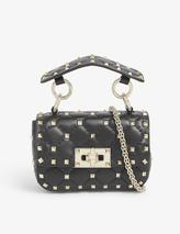 Rockstud quilted leather cross-body bag in Black